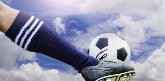 Kicking football ball
